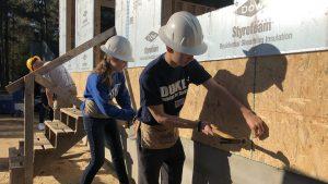 Duke students hammering nails for Habitat for Humanity