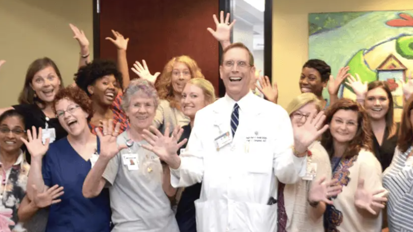 A group of people doing jazz hands